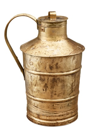 Ancient brass jug isolated.
