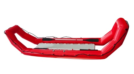 Red Inflatable Lifeboat isolated. Clipping path included photo