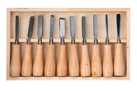 gouge: Chisel set in wooden box isolated over white