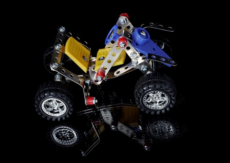 Metal meccano car isolated on black Stock Photo - 10401078