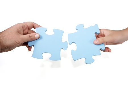 Man-woman joining puzzle concept isolated on white Stock Photo