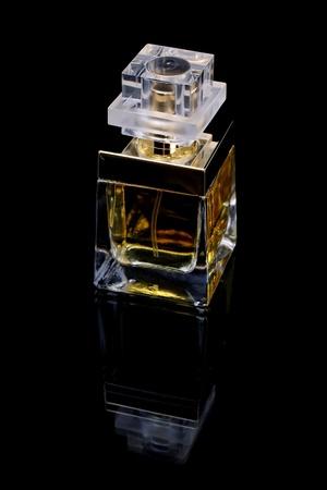 Perfume bottle over black background photo