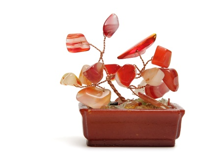 Hand made plant from gem and wires in flower pot isolated on white