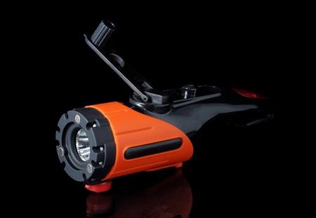dynamo: Modern electric torch with dynamo on a black background