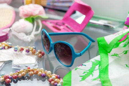 Blue sunglasses and other young girl glamour things Stock Photo