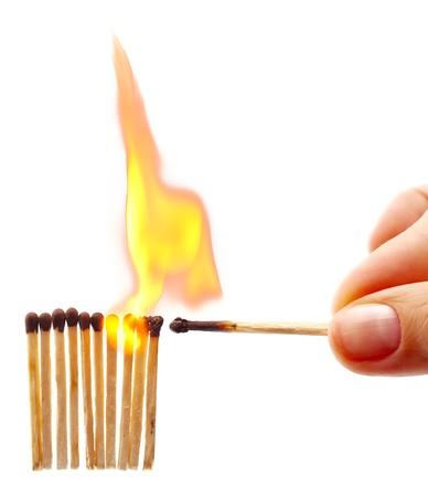 cerillos: Mujer fuego la mano de una fila de partidos aislados en blanco Foto de archivo