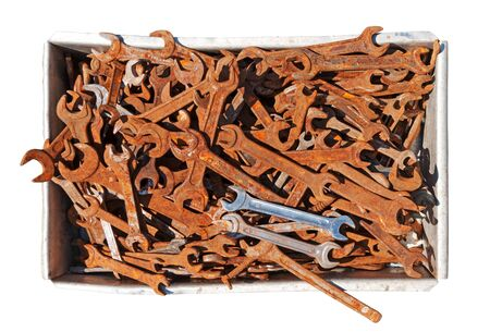 crate: Old rust spanners in box isolated on white