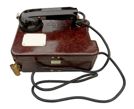 Old military field telephone isolated
