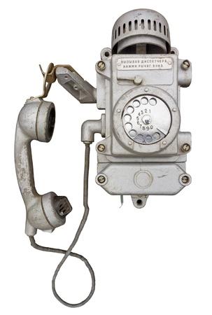 vandal: Old huge ugly vandal proof phone Stock Photo