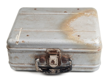 Old dirty metal box isolated on white  photo