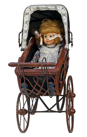 baby carriage: Vintage toy pram with doll isolated