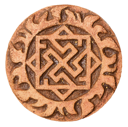 Old symbol on terracotta amulet photo