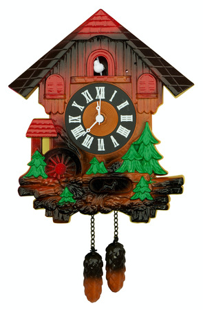 wooden clock: Old cuckoo clock isolated on white