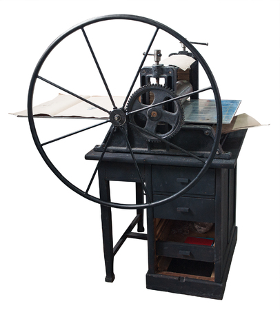 printing logo: Restored old letterpress at work. Clipping path included. Stock Photo