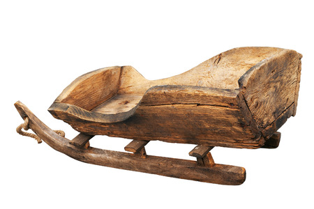Ancient sledge isolated on white