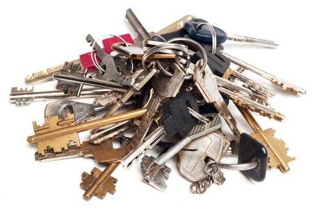 heap: Heap of old keys isolated on white Stock Photo