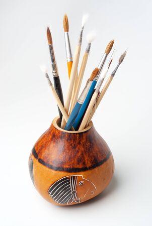 New paintbrushes isolated on white;