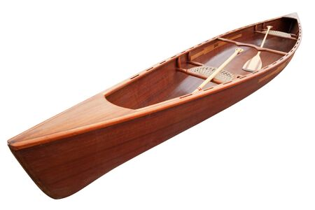 New canoe with paddles isolated on white. Clipping path included. Stock Photo