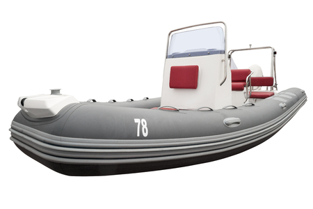 Rubber motor boat isolated on white. Clipping path included.