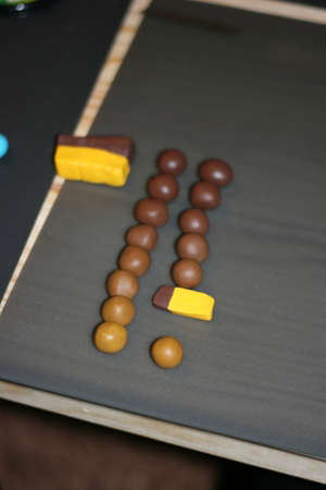 malleable: Multi-colored pieces of clay in the shape of balls , master class on modeling . Stock Photo