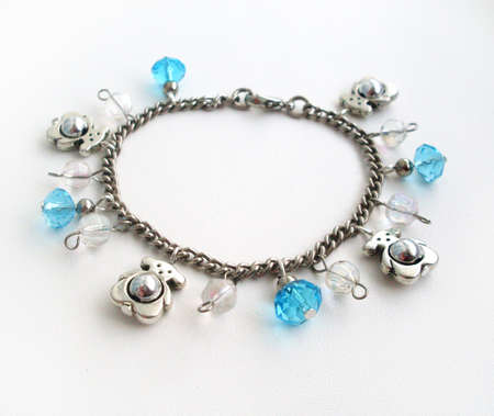 bangles hand: Bracelet on a chain with elements of winter decor Stock Photo