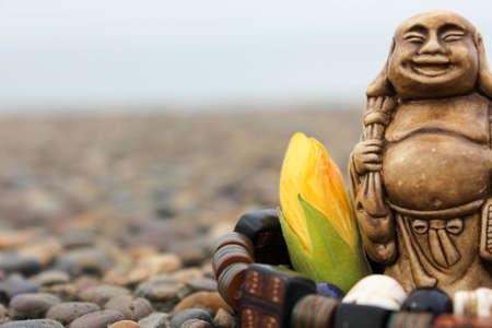 budda: Bracelet and flower with budda figurine composition