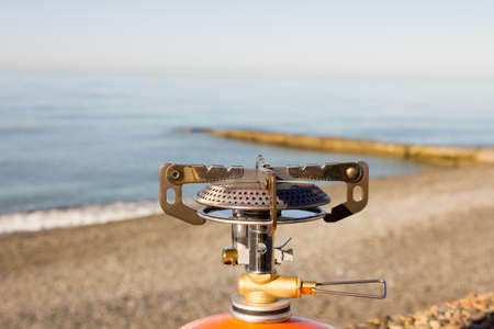 primus: portable gas burner on the beach camping stove