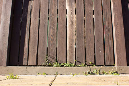 homely: low wooden fence brown boards, backgrounds for illustrations Stock Photo