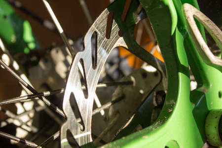 spokes: bicycle hub with spokes close-up in the sun