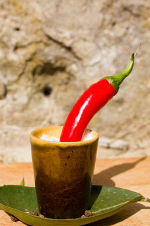 capsaicin: Red hot chili peppers and spices on a wooden board