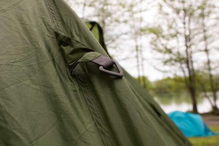 Carbine on a camp tent closeup green