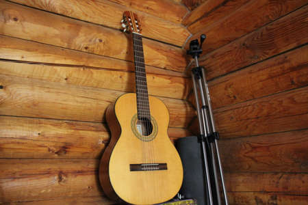 chimes: Acoustic guitar on the background of wooden boards