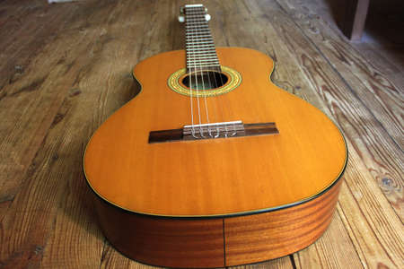 wood staves: Acoustic guitar on the background of wooden boards