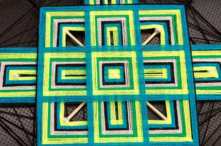 sacral symbol: Tibetan mandala of colored thread and bamboo sticks Stock Photo