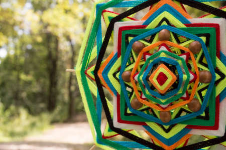 weave ball: Tibetan mandala of colored thread and bamboo sticks Stock Photo