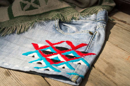 kilim: Embroidery colorful thread Navajo ornament jeans blue Stock Photo