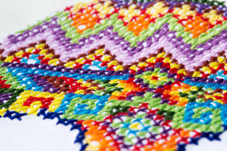 allover: Embroidery colorful thread Navajo ornament jeans blue Stock Photo
