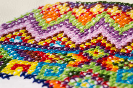 navajo: Embroidery colorful thread Navajo ornament jeans blue Stock Photo