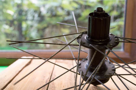 motoring: bicycle wheel with spokes in the repair shop Stock Photo