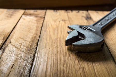 wrench on a wooden background in the workshop Stock Photo