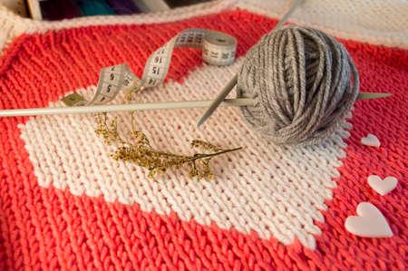knitting and yarn on a beautiful background