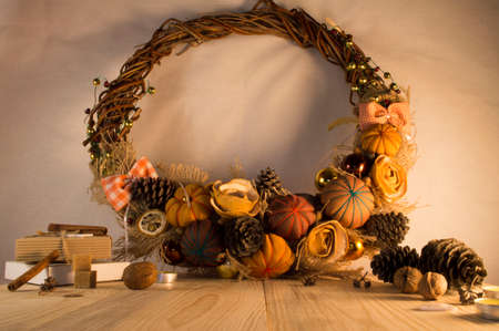 Christmas wreath on the door of handmade. Christmas decoration with pine cones , balls and ribbons.