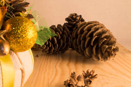 felicitation: Christmas wreath on the door of handmade. Christmas decoration with pine cones , balls and ribbons.