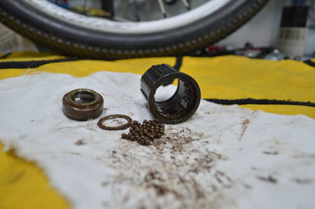 Disassembled bicycle bushing with spokes close up in the workshop