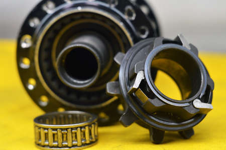 hole: Disassembled bicycle bushing with spokes close up in the workshop
