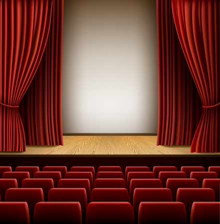 A theater stage with red curtain and red seats,