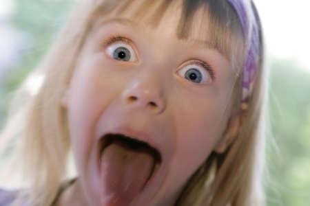 blonde little girl: portrait of a bold kaukasian girl Stock Photo