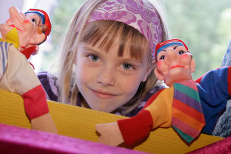 kaukasian girl playing puppet theater Stock Photo