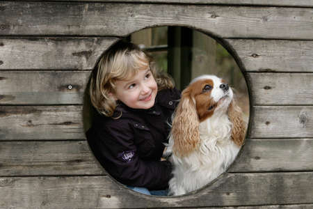 little girl with spaniel dog