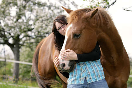 friendship women: snuggling with a horse